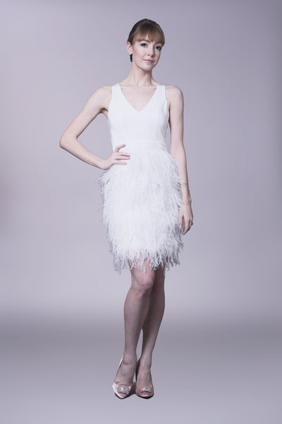 Fitted sheath dress with feather skirt