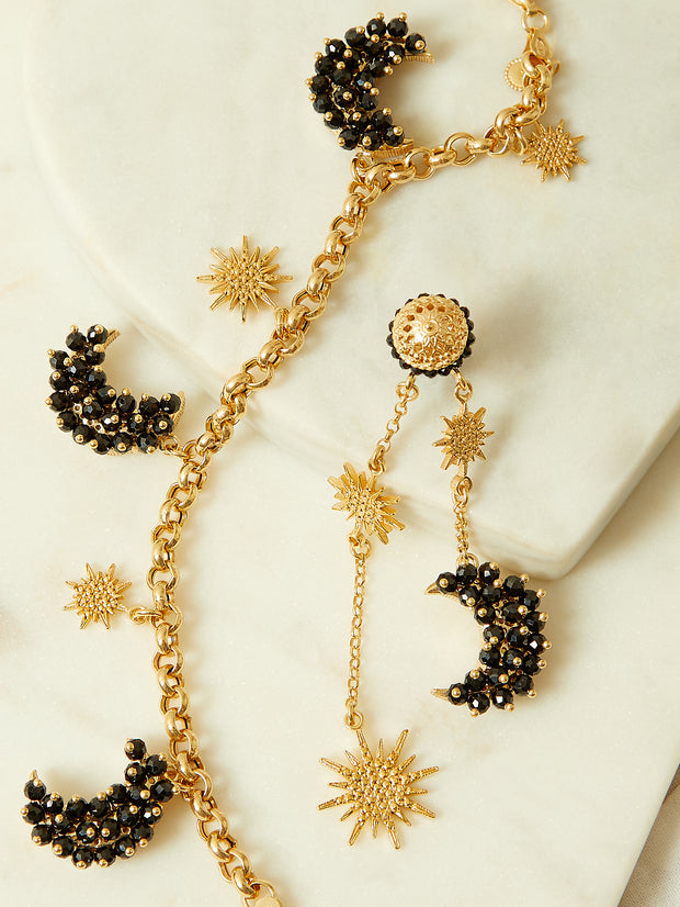 soru jewellery black spinel luna earrings and bracelet from the celestial collection in gold plated silver with star charms