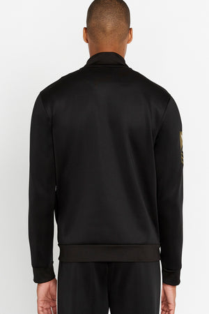 Back view of men wearing a black jet track jacket