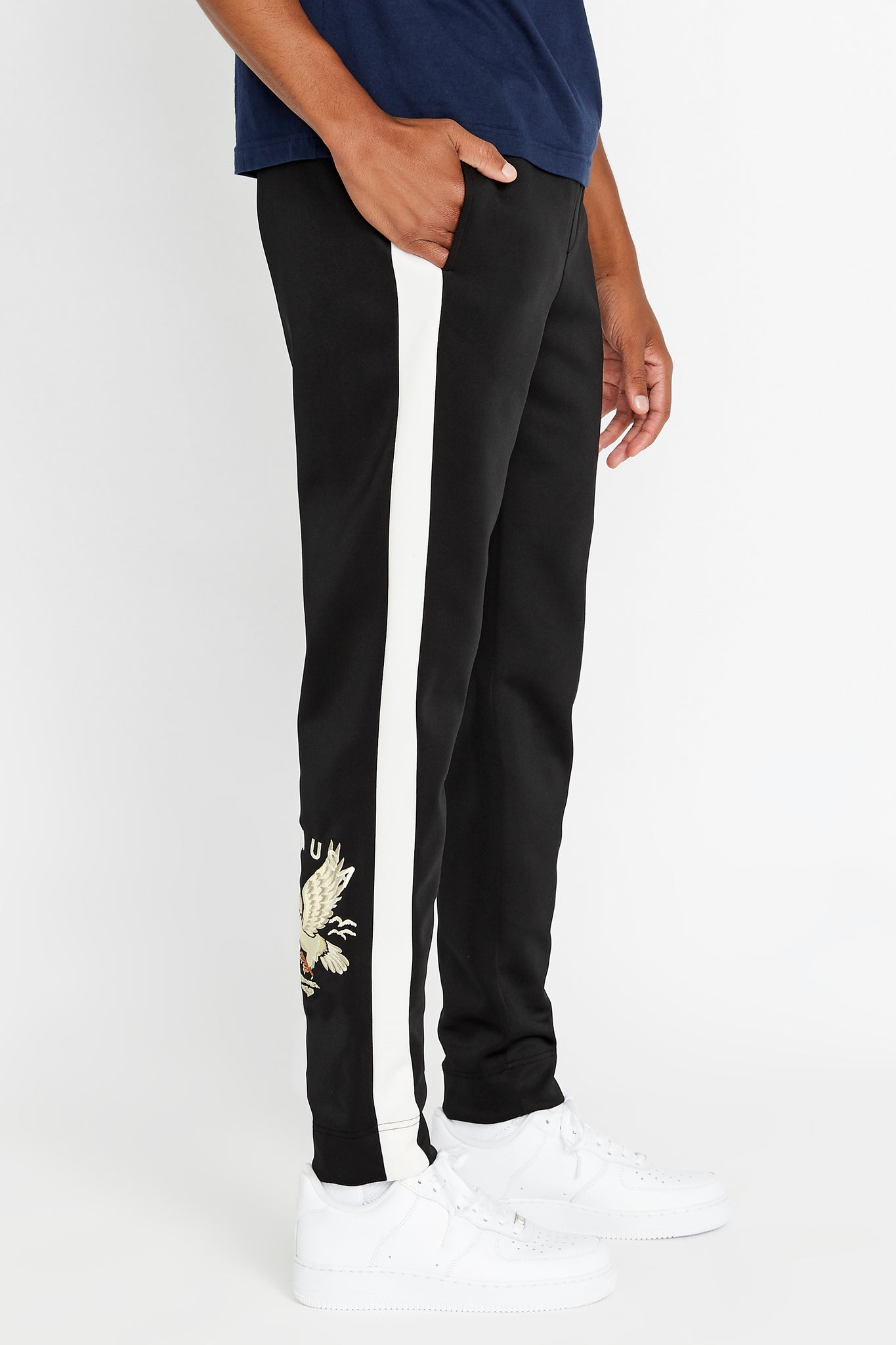 Side view of men's neoprene jogger pants with side white stripe and Avirex embroidery logo