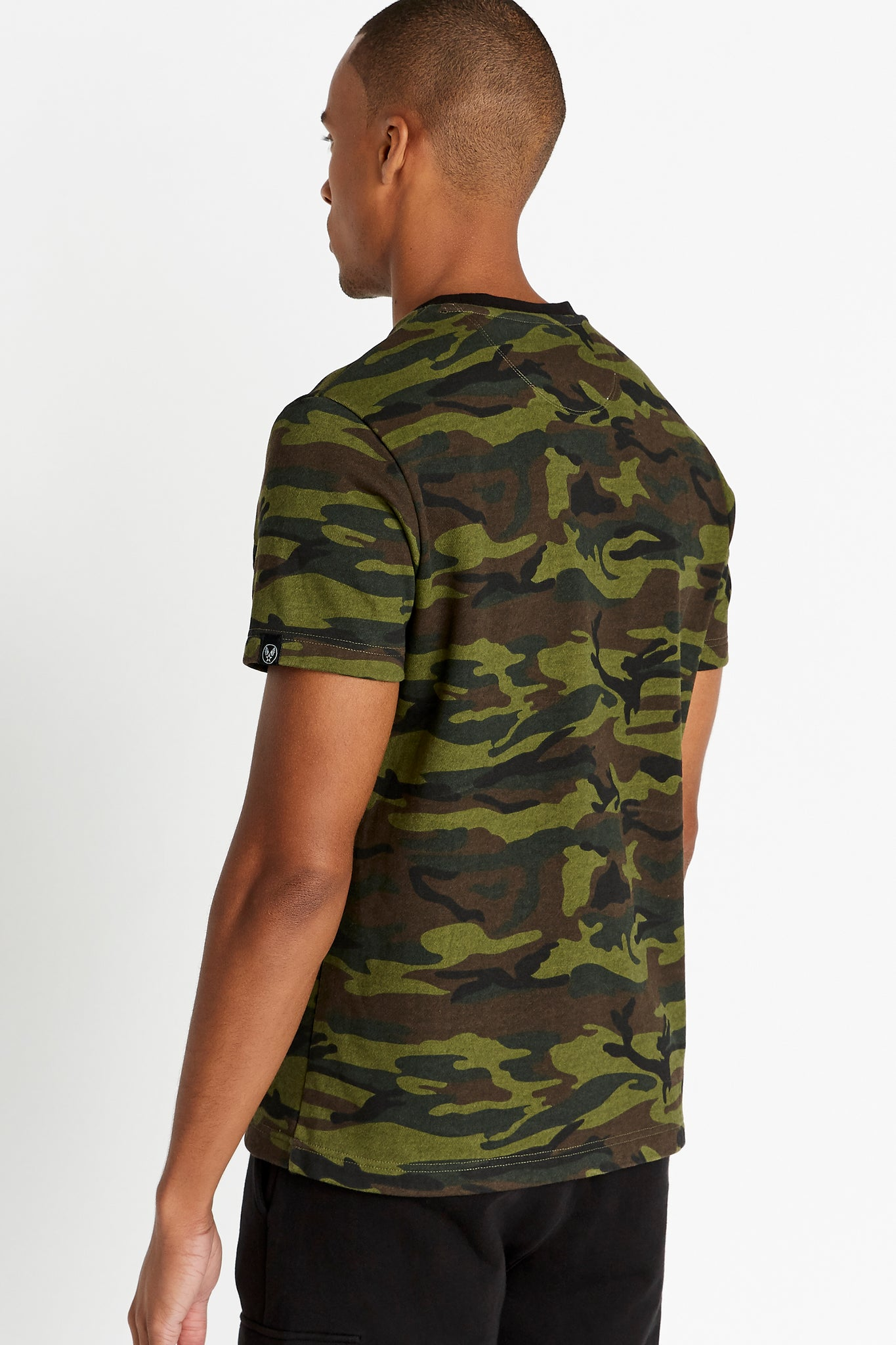 Side view of men wearing a camo print short sleeve crew T-shirt
