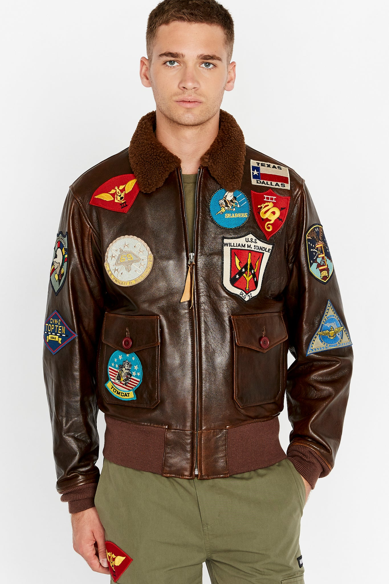 Front view of men wearing a brown fully zipped Top Gun G-1 leather jacket with shearling fur lined collar and colorful Top gun patches design on bodice