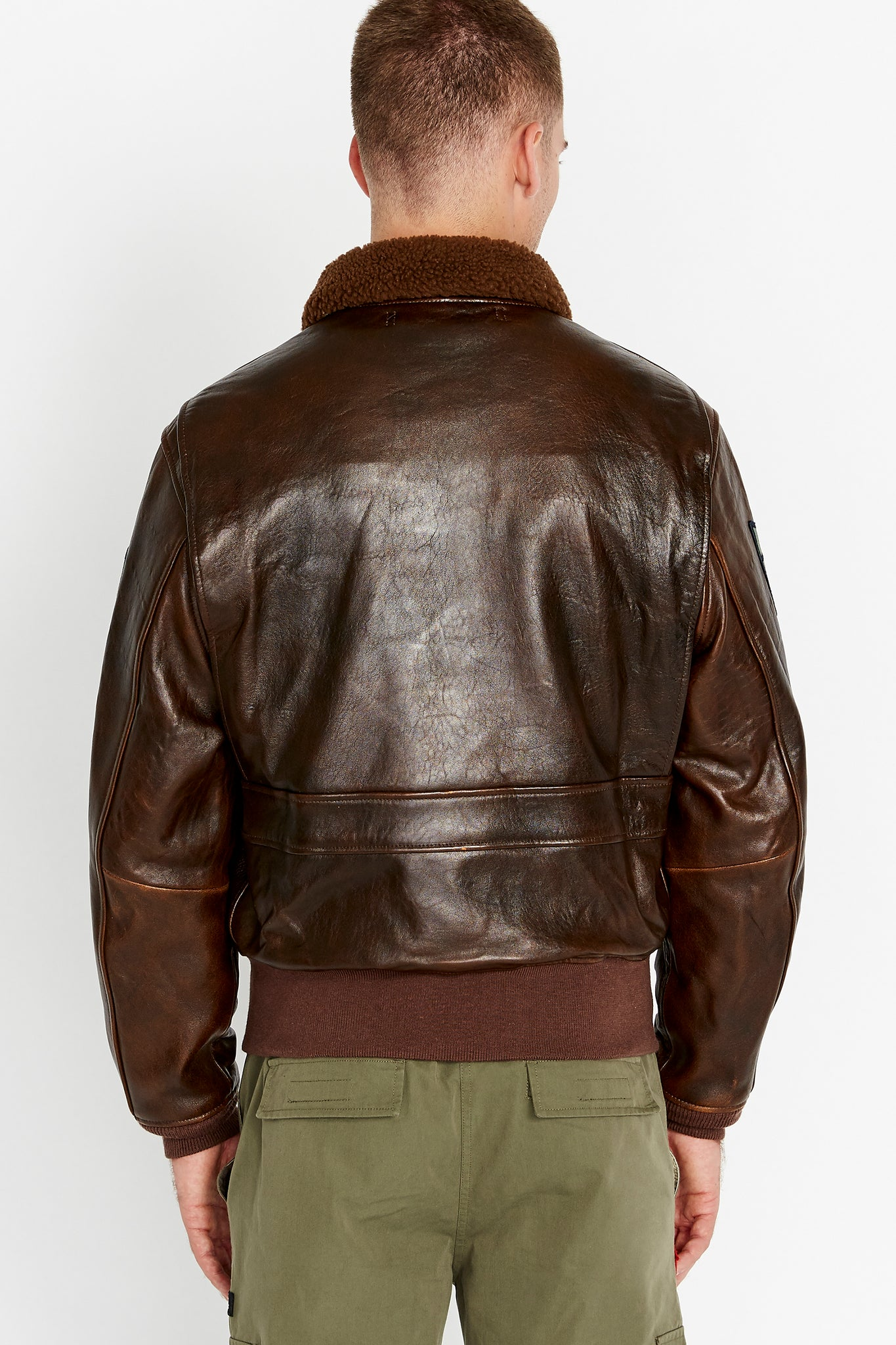 Back view of men wearing a brown Top Gun G-1 leather jacket with shearling fur lined collar