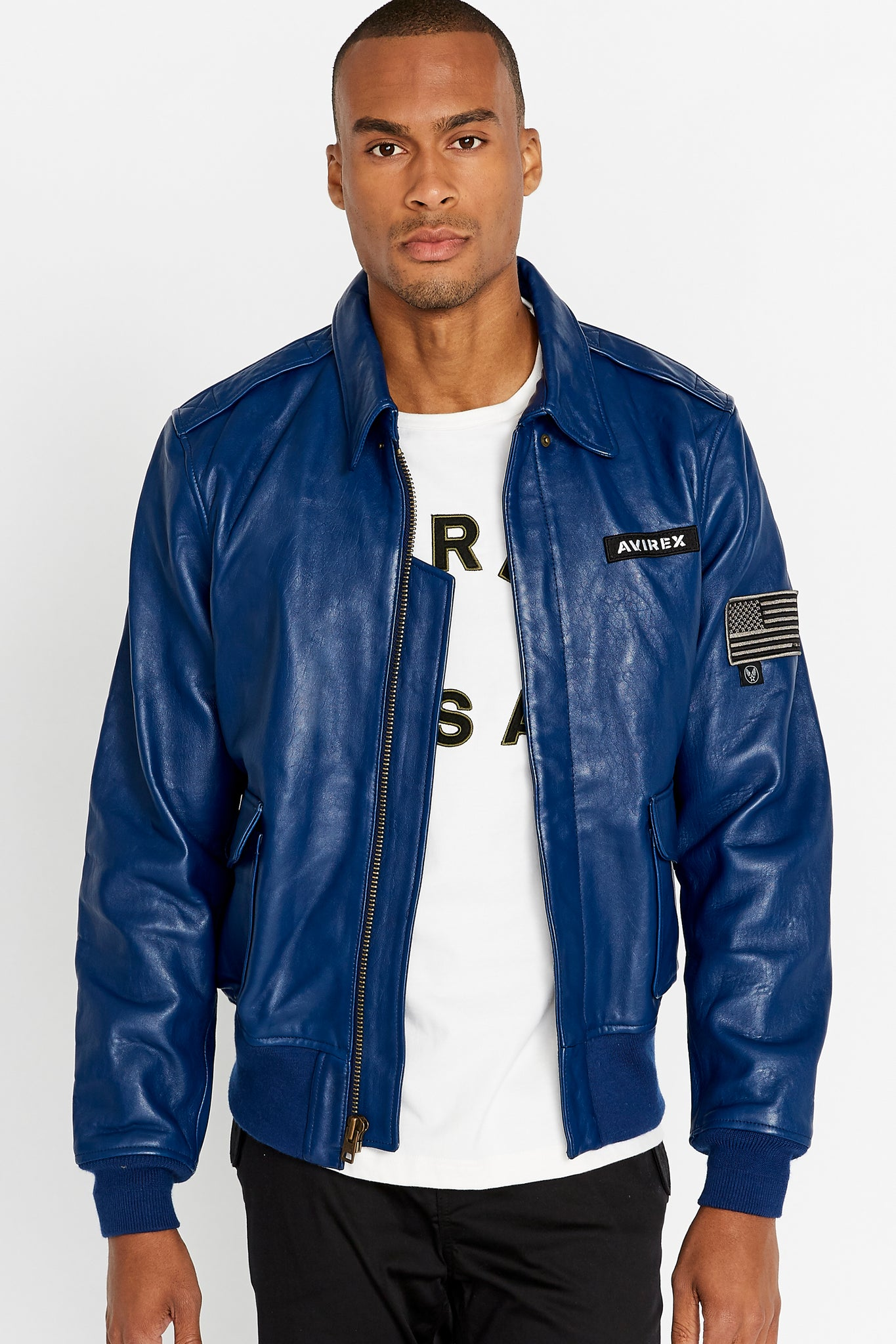 Front view of men wearing an open blue leather bomber jacket with snap down collar and two flap snap prockets, Avirex logo patch on the chest and one patch on the left sleeve