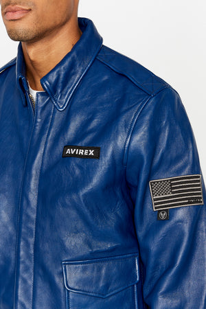 Detailed view of Avirex logo patch on the chest and one patch on the left sleeve