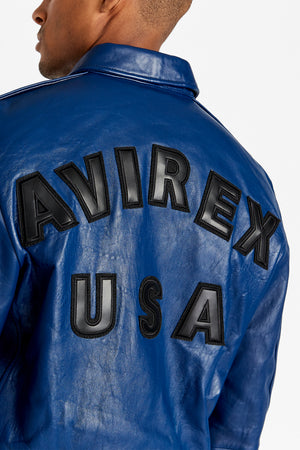 Detailed view of bold text lettering Avirex USA on the back