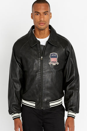 Front view of men wearing a fully zipped black original aviation bomber leather jacket with patch on the chest and stripes on knit ribs