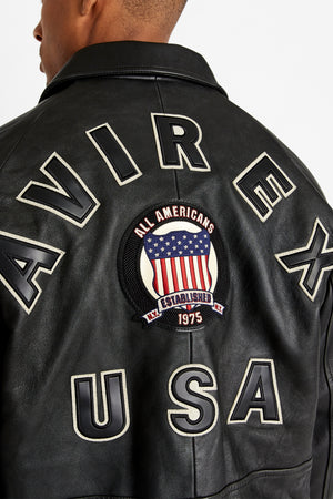 Detailed view of bold back text lettering Avirex USA with round patch in the middle