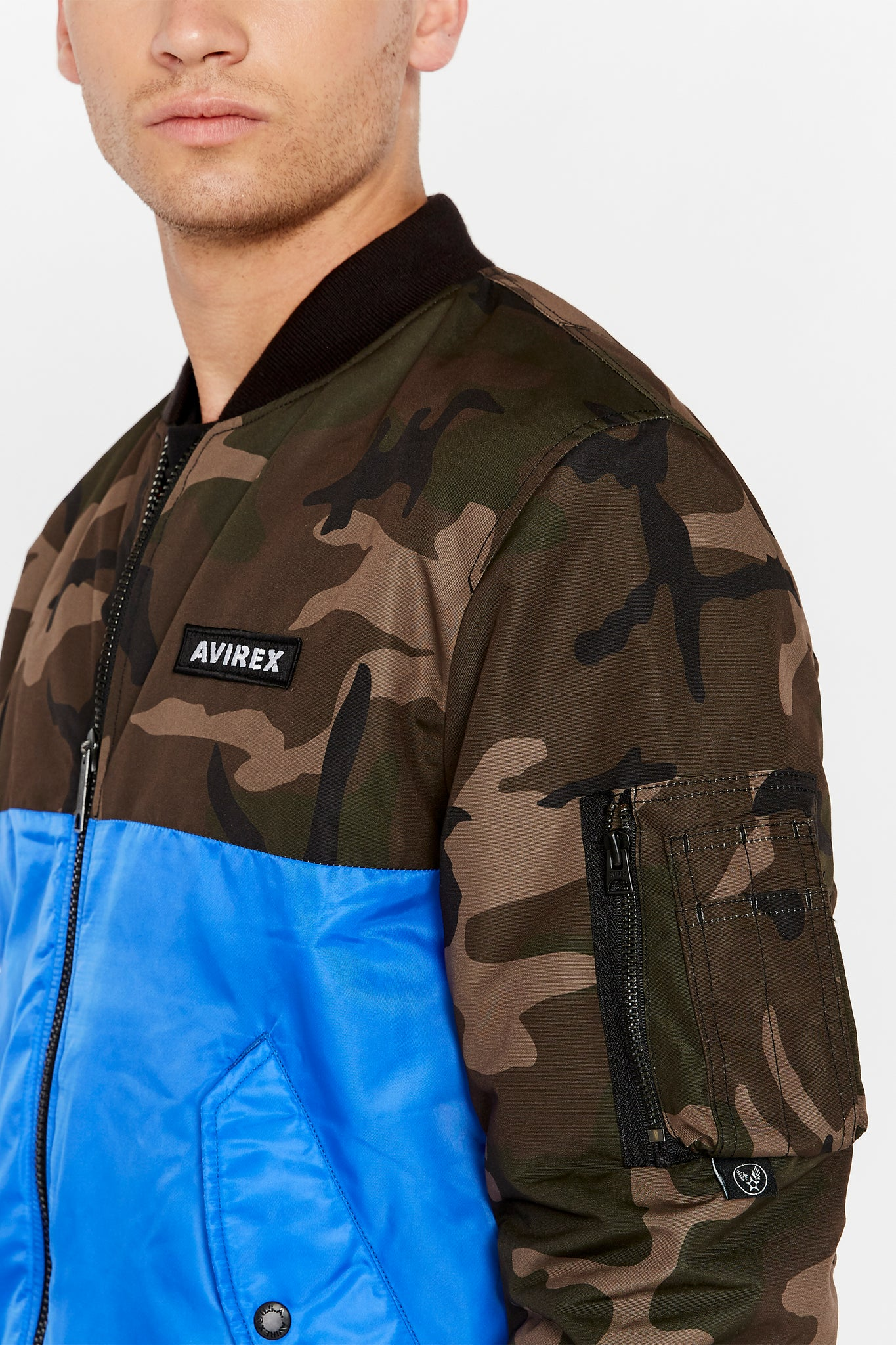 Detailed view of Avirex logo patch on the chest and one utility pocket on left sleeve