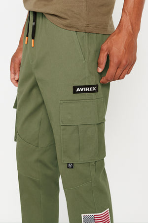 Detailed view of Avirex patch above side cargo pocket and small logo tag under pocket