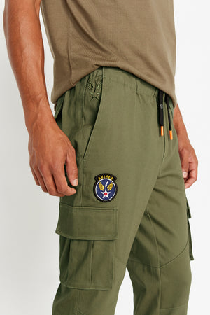 Detailed view of round logo patch above side cargo pocket
