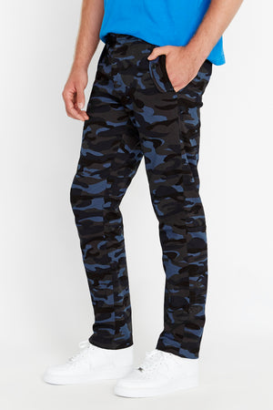 Side view of navy camo print pants with two pockets on the side