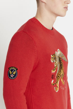 Detailed view of front flying tiger embroidery and a patch on the right sleeve