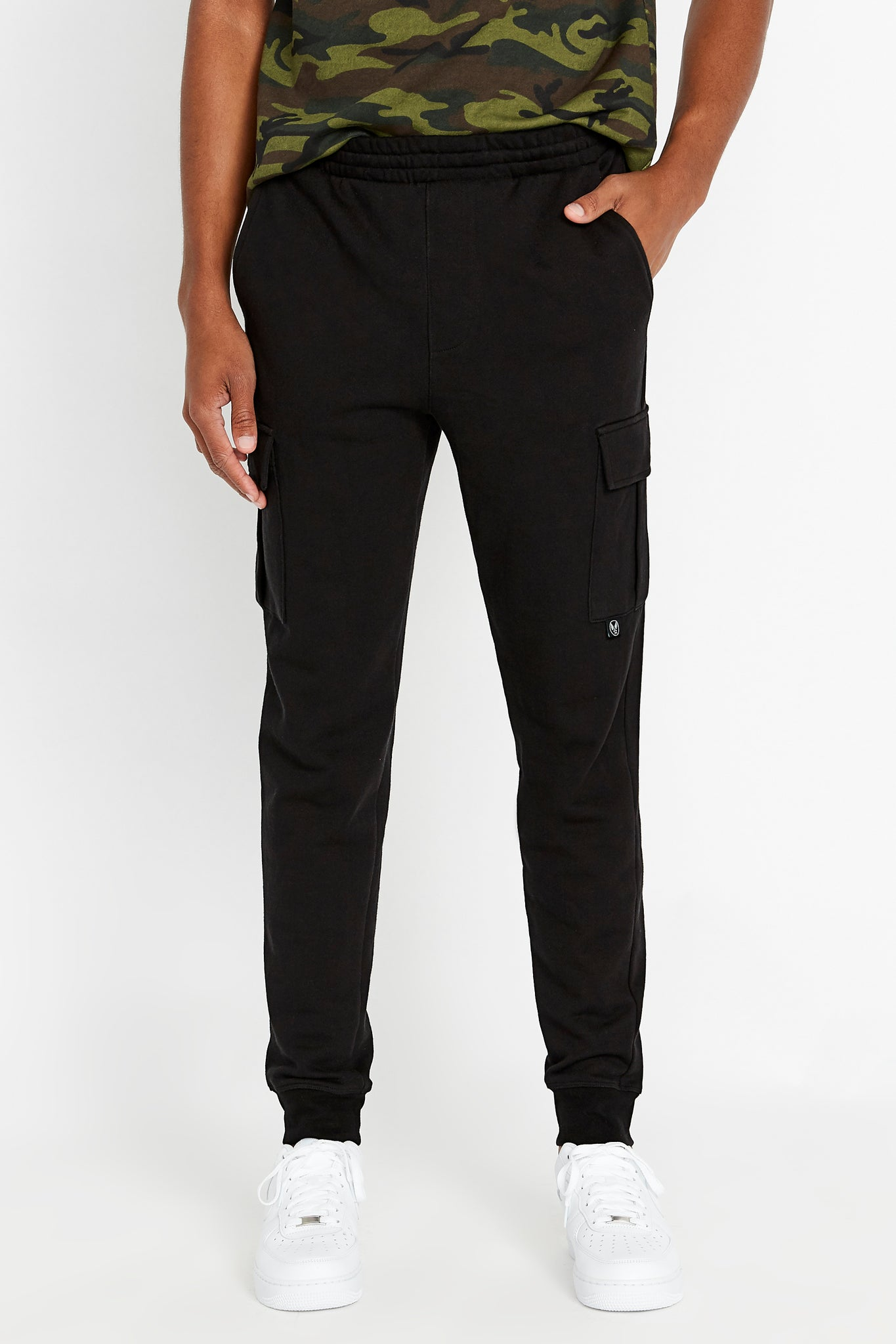 Men's drawstring pant with cargo pockets.  Elastic band closing at hem
