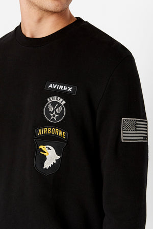 Detailed view of patches on left chest and patch on left sleeve