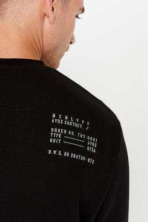 Detailed text near right shoulder on the back