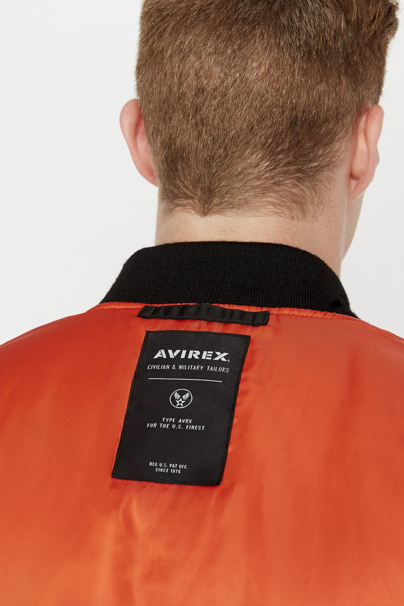 Detailed view of back patch under collar of reversed orange side