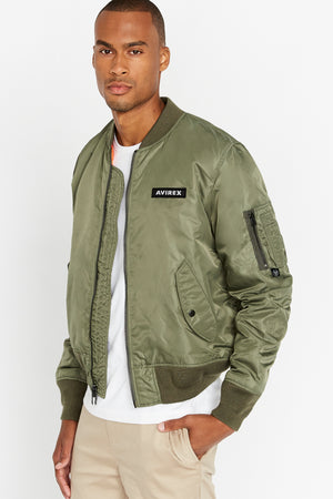 Side view of men wearing an open olive original aviation bomber nylon jacket with Iconic utility pocket on sleeve and two side pockets