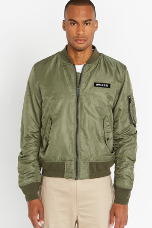 Front view of men wearing a fully zipped olive original aviation bomber nylon jacket with Iconic utility pocket on sleeve and two side pockets
