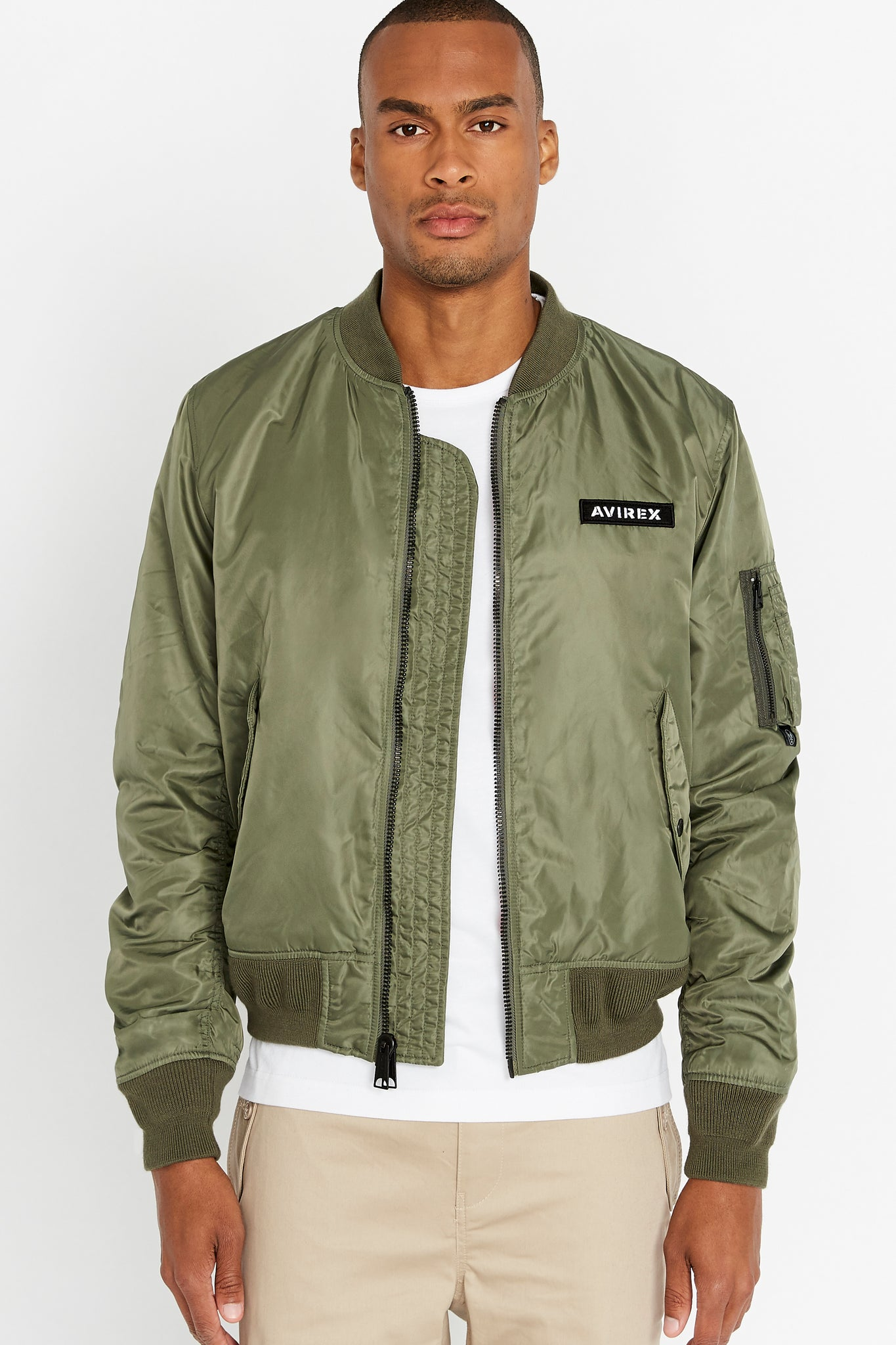 Front view of men wearing an open olive original aviation bomber nylon jacket with Iconic utility pocket on sleeve and two side pockets