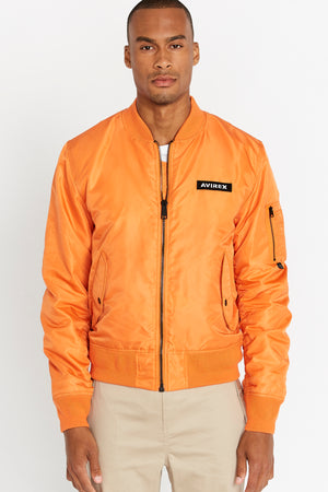 Front view of men wearing a fully zipped orange original aviation bomber nylon jacket with Iconic utility pocket on sleeve and two side pockets
