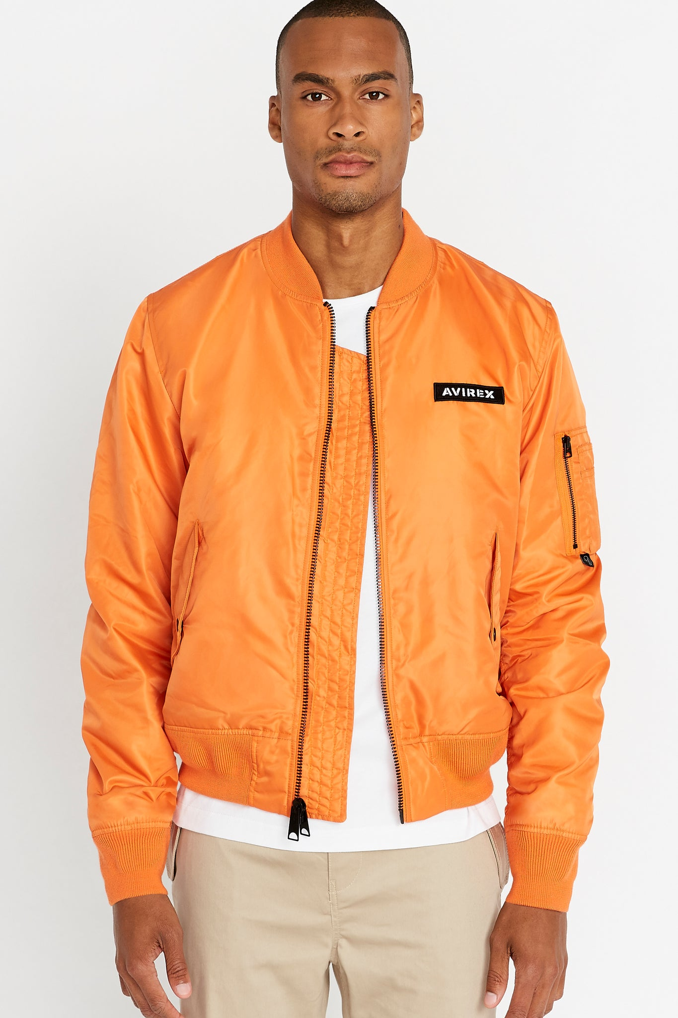 Front view of men wearing an open orange original aviation bomber nylon jacket with Iconic utility pocket on sleeve and two side pockets