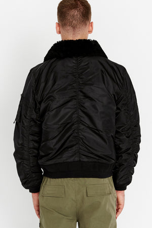 Back view of men wearing a black bomber jacket with a sherpa-lined collar