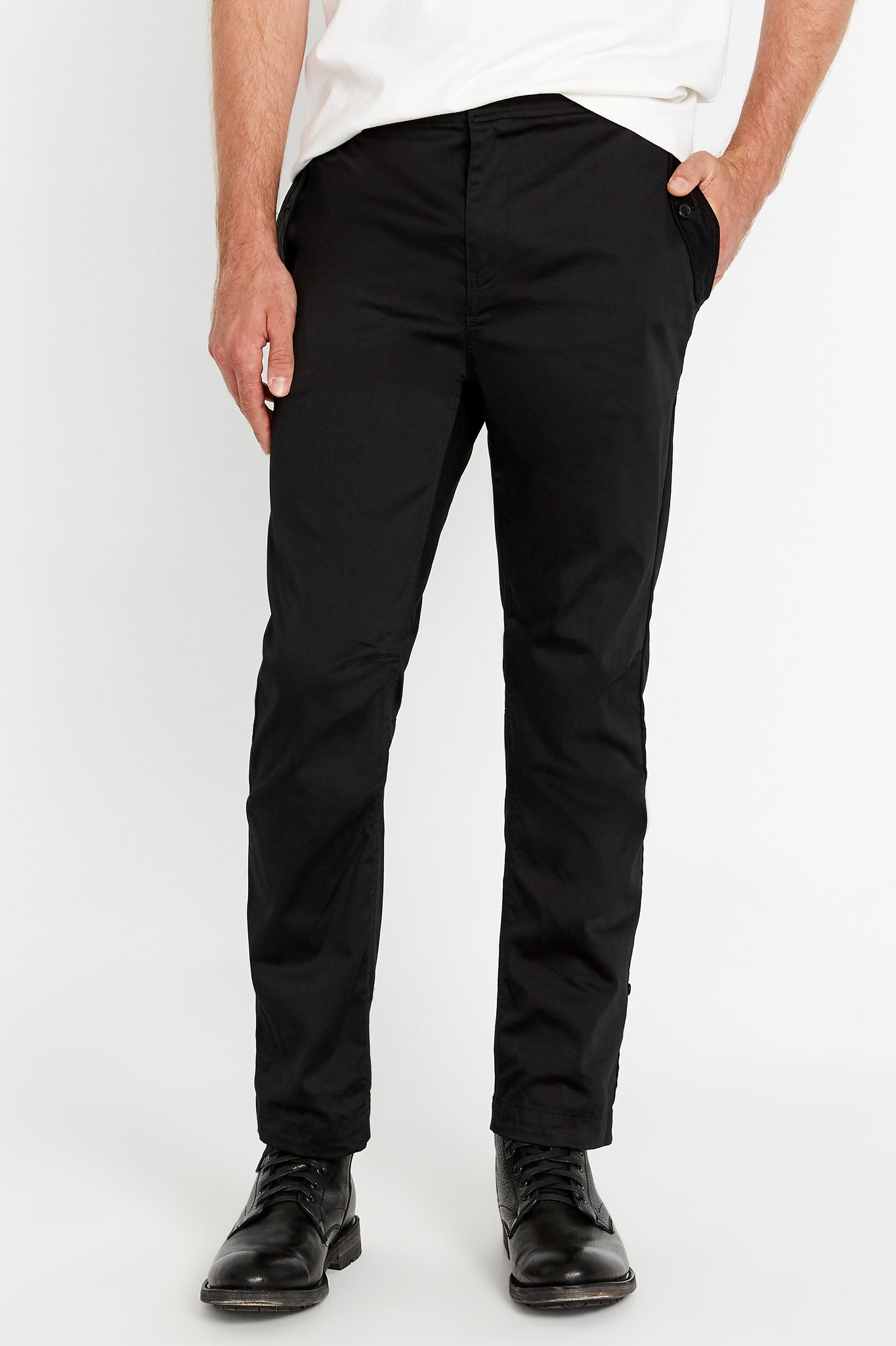 Front view of black pants with rolled up hem and pockets on both sides