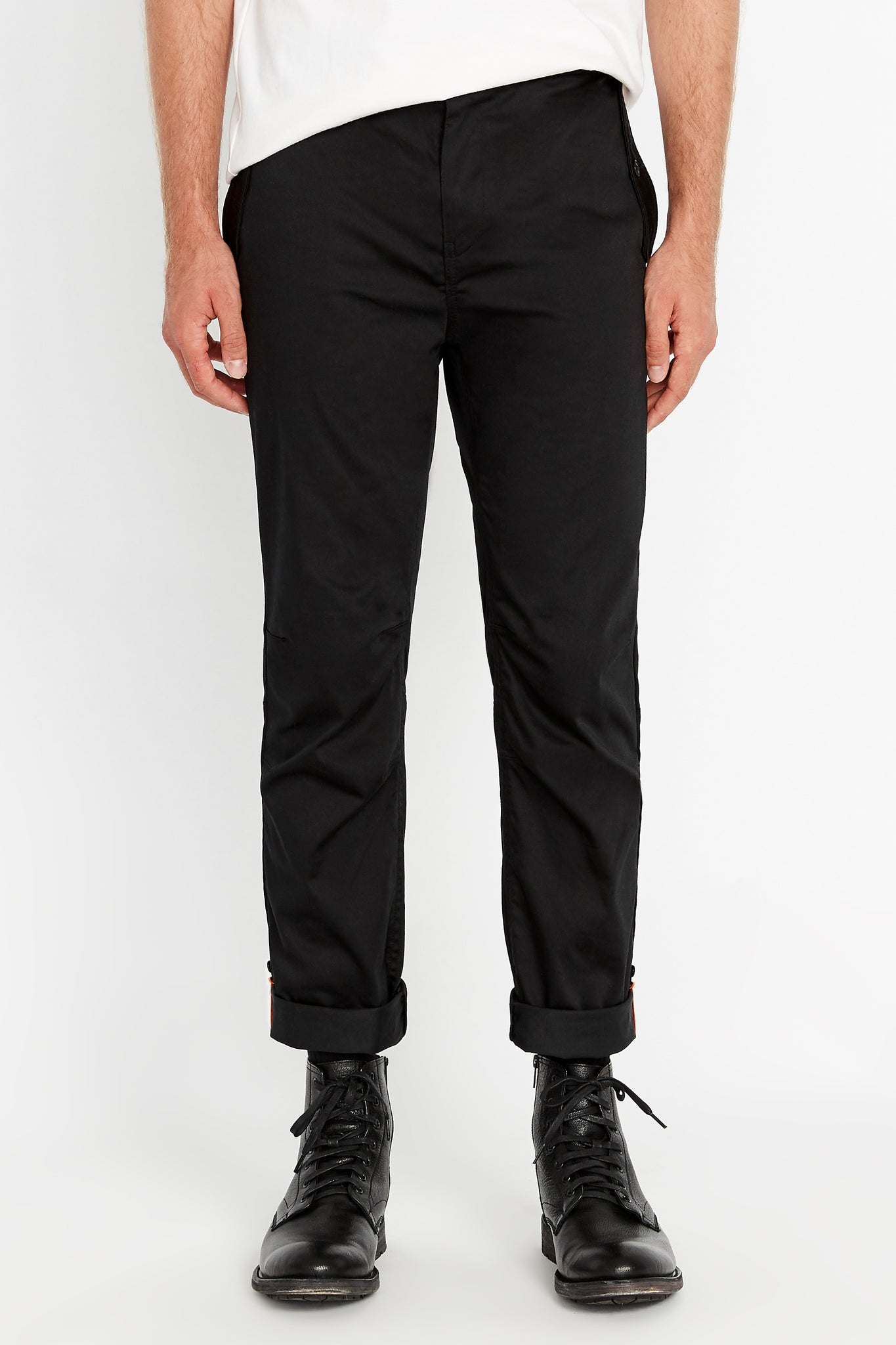 Front view of black pants with rolled up hem
