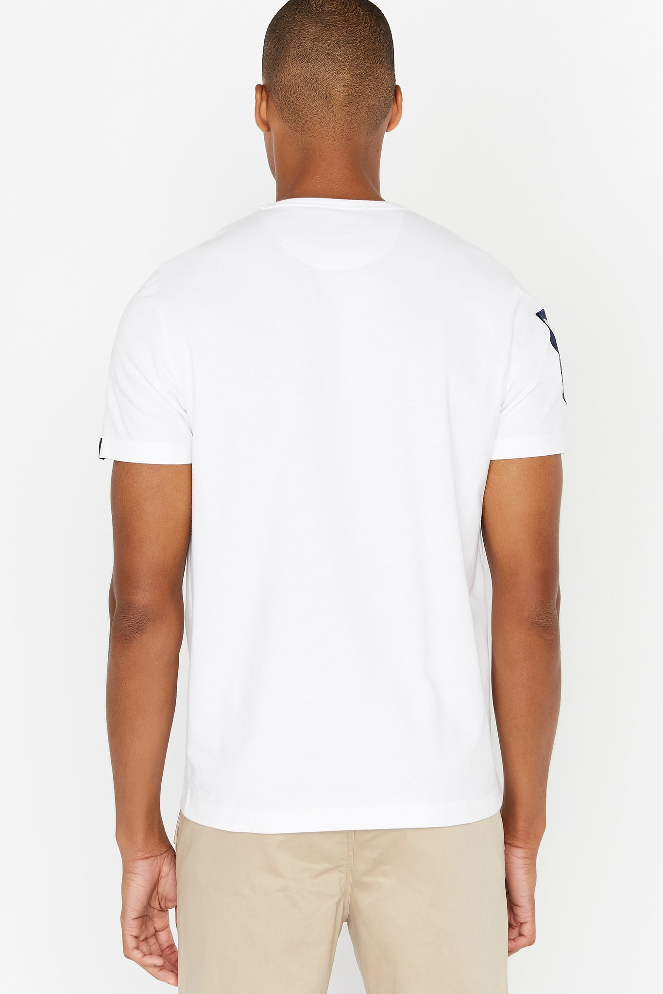 Back view of men wearing a white short sleeve crew T-shirt