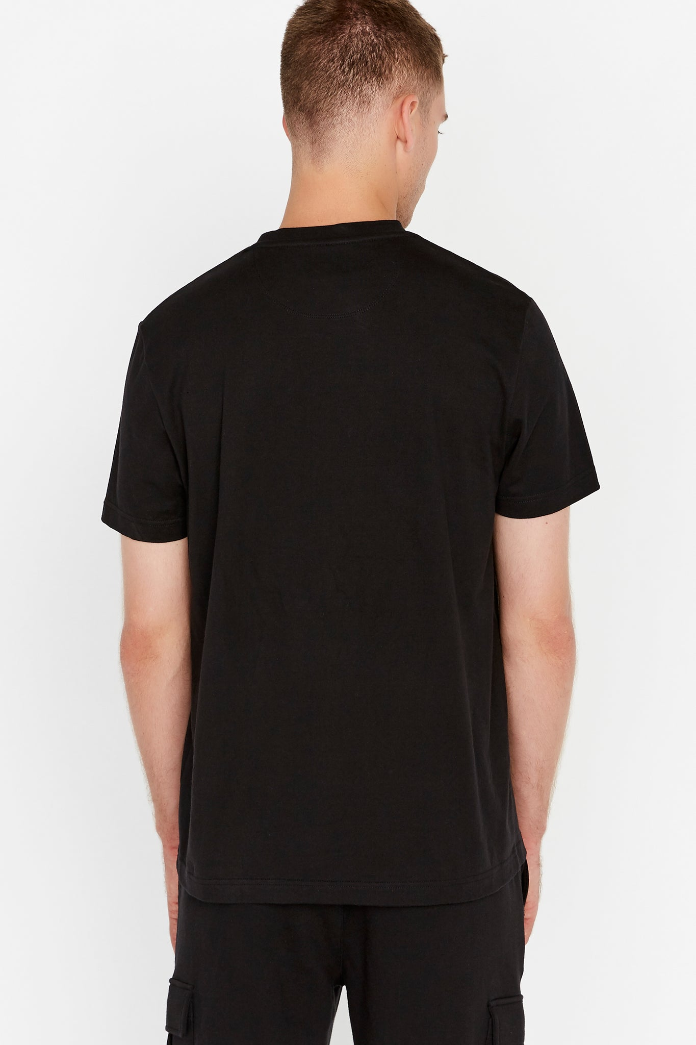 Back view of men wearing a black short sleeve crew T-shirt
