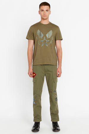 Full view of men wearing an olive short sleeve crew T-shirt with front Avirex airforce wing-star print and olive pants