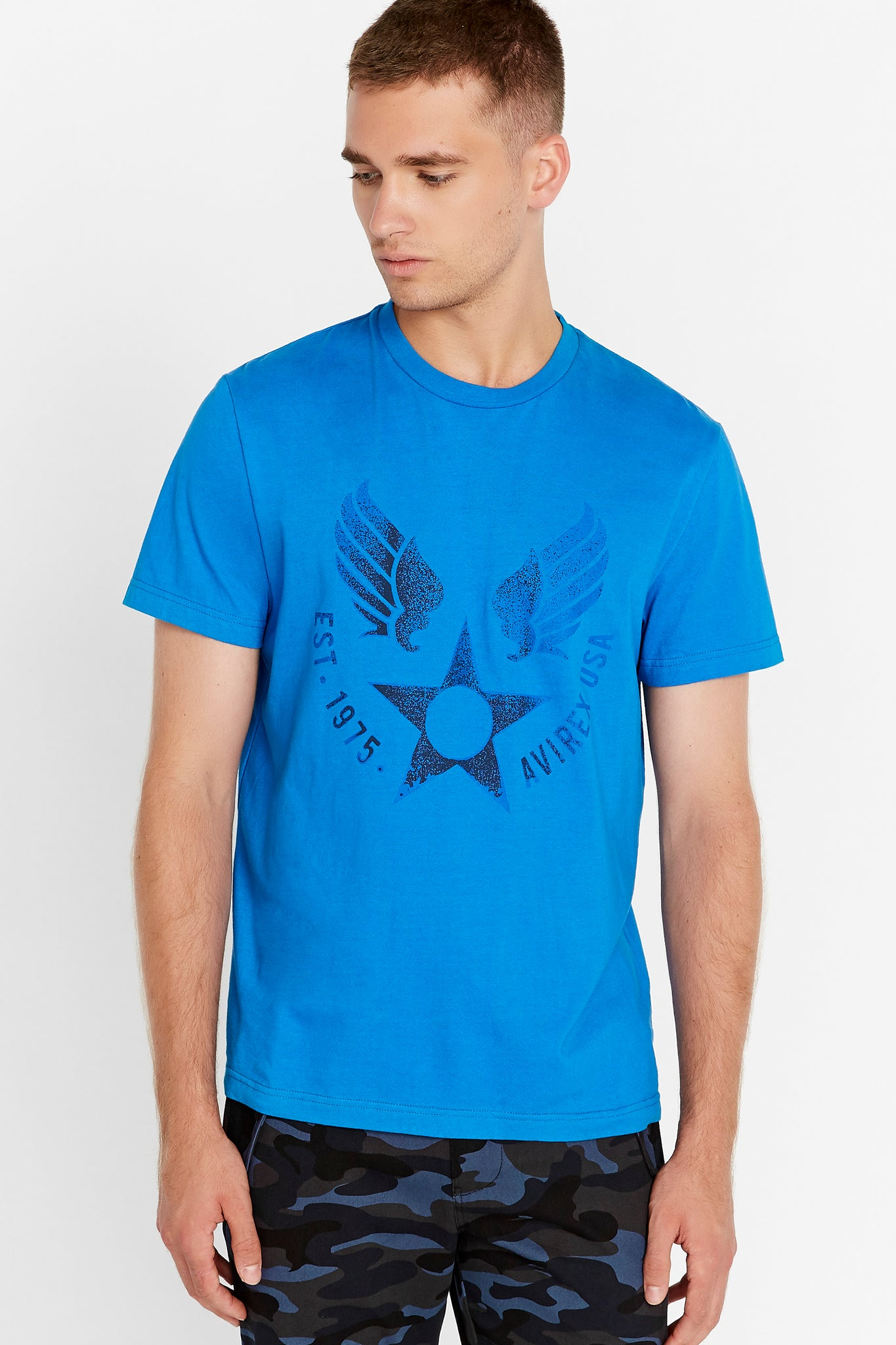 Men wearing a royal blue short sleeve crew T-shirt with front Avirex airforce wing-star print