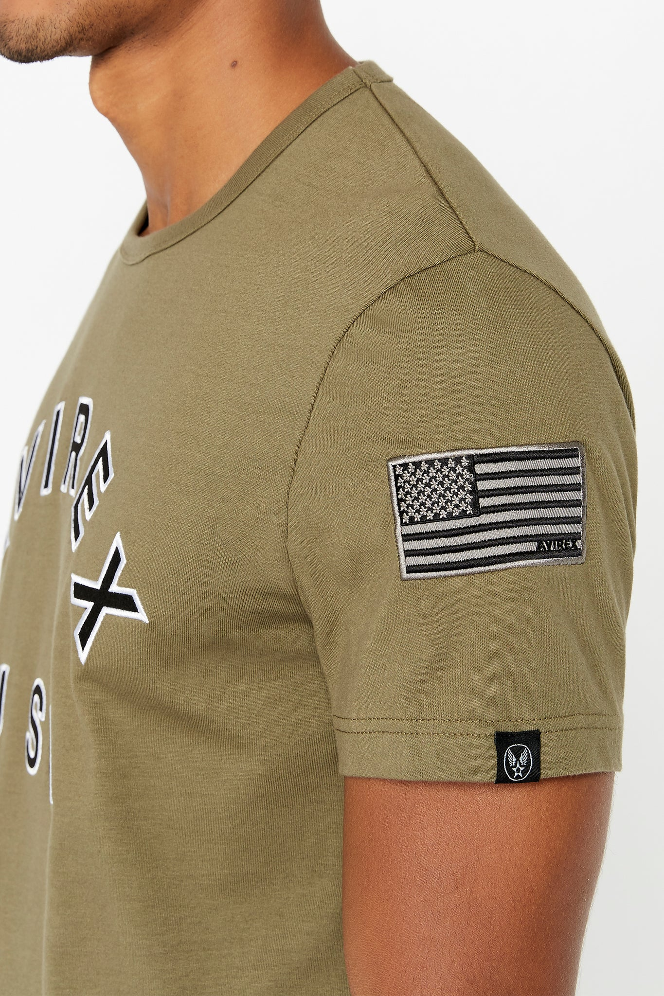 Detailed view of patch and small logo tag on left sleeve