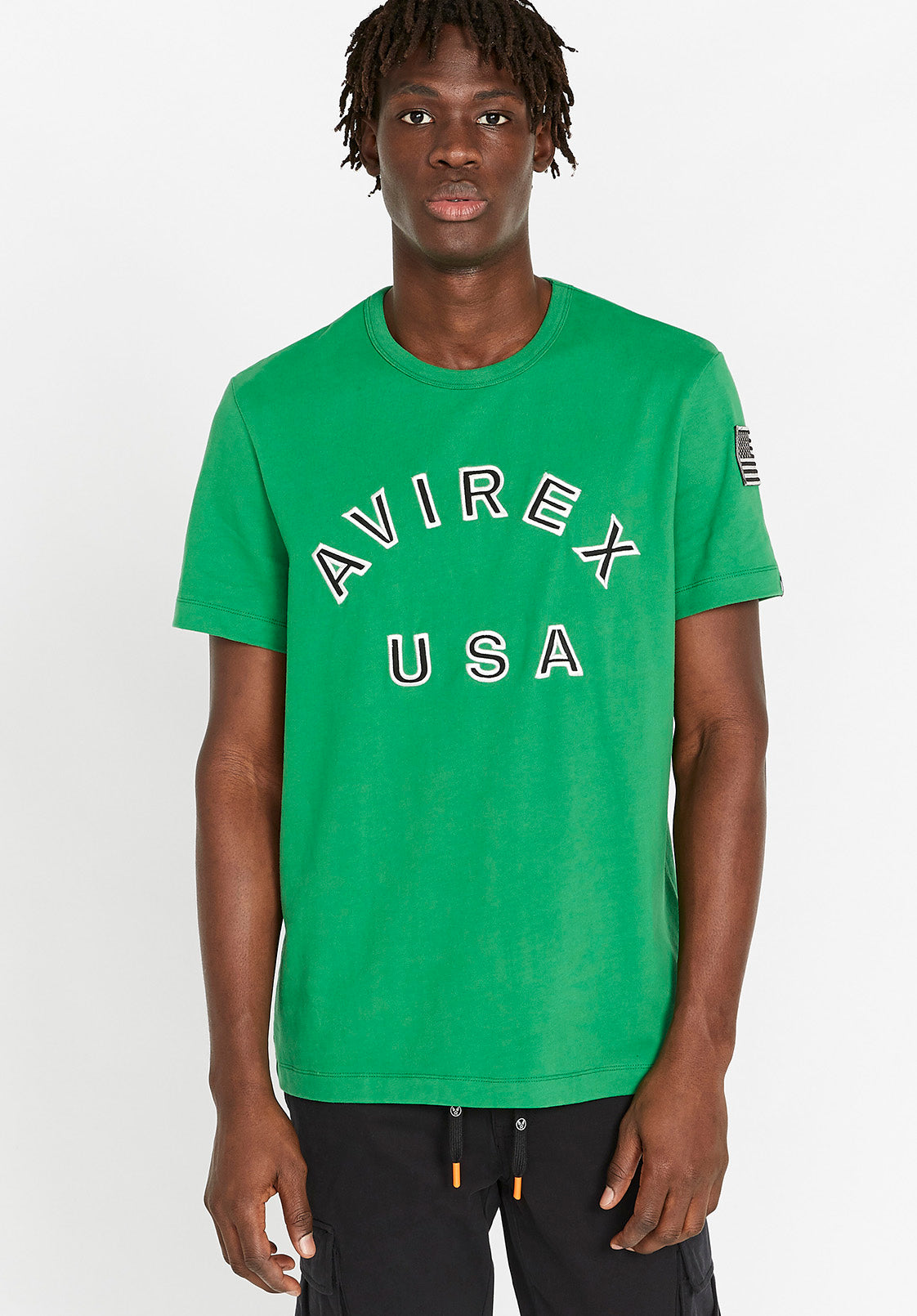 Men wearing a green t-shirt with Avirex USA embroidery in black & white on front chest