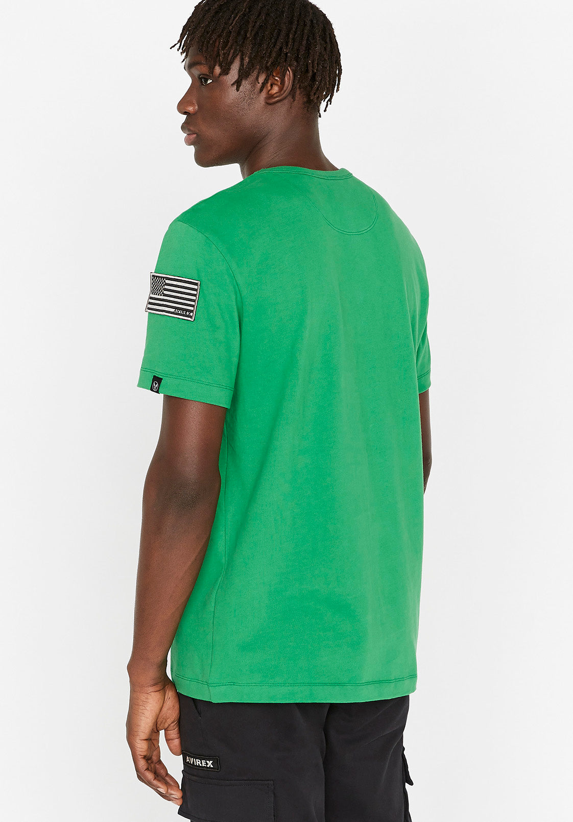 Back view of men wearing a green t-shirt with USA flag patch on left sleeve
