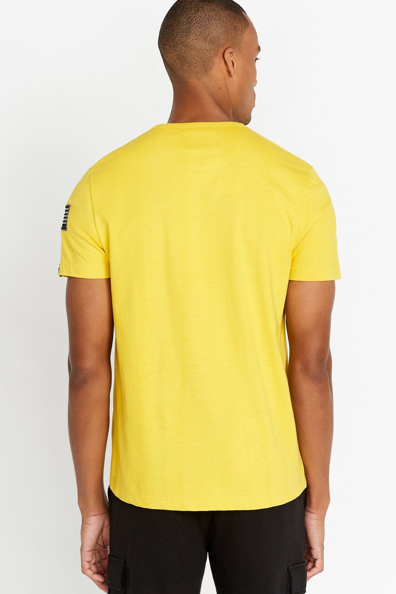 Back view of men wearing a yellow short sleeve crew T-shirt
