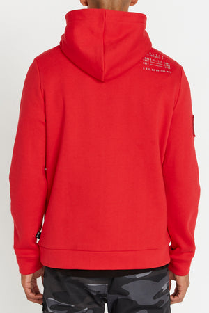Back view of men wearing a red hoodie sweatshirt letters print on right shoulder