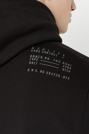 Detailed view of text print on the back shoulder