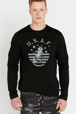 Men wearing a black long sleeve crew T-shirt with front Tomcat graphics and a patch on the right sleeve
