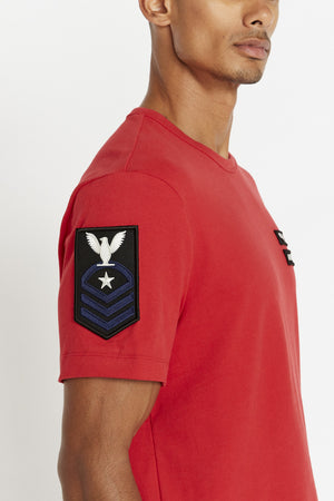 Detailed view of contrast patch on right sleeve