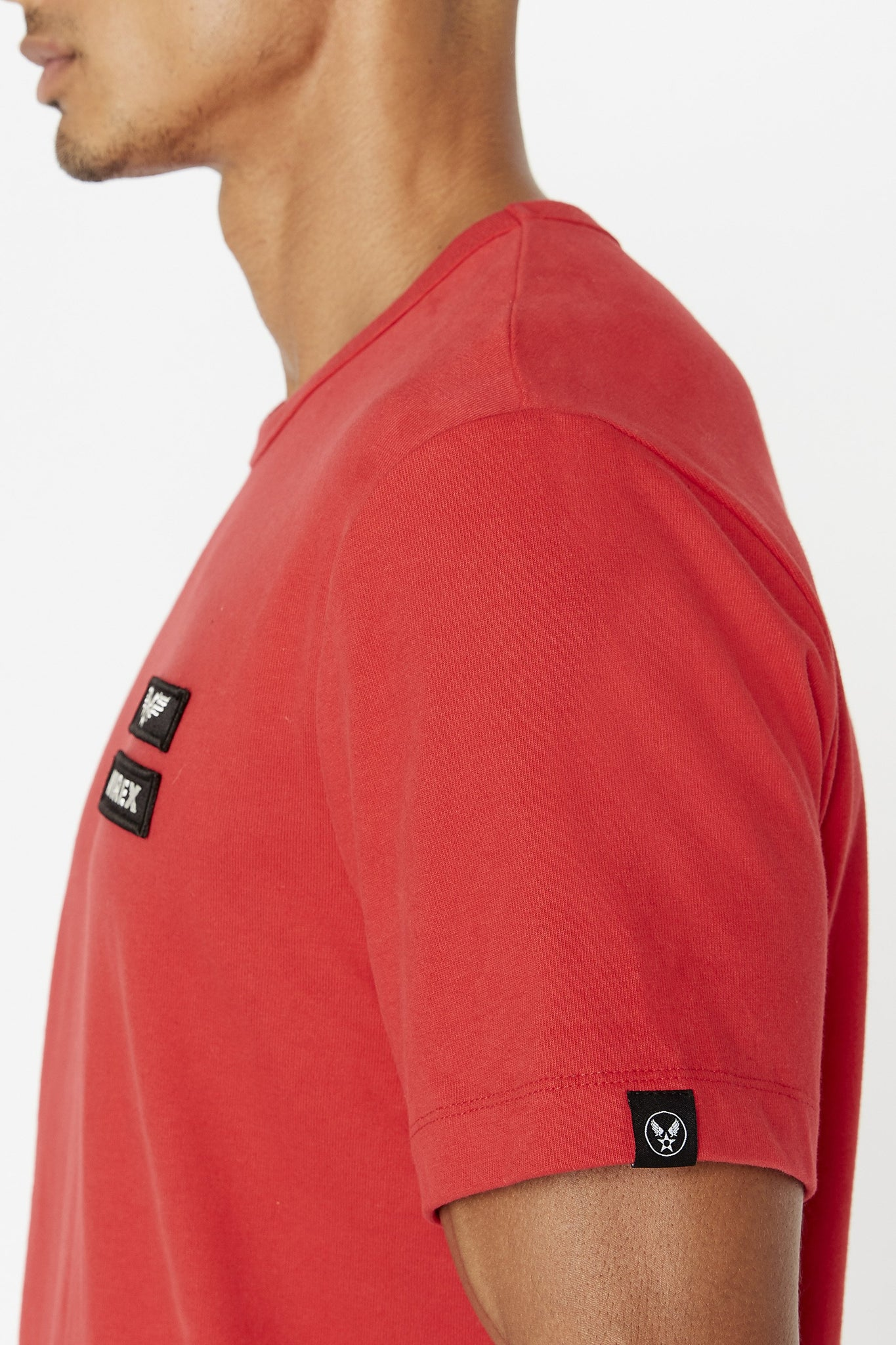 Detailed view of small logo tag on left sleeve