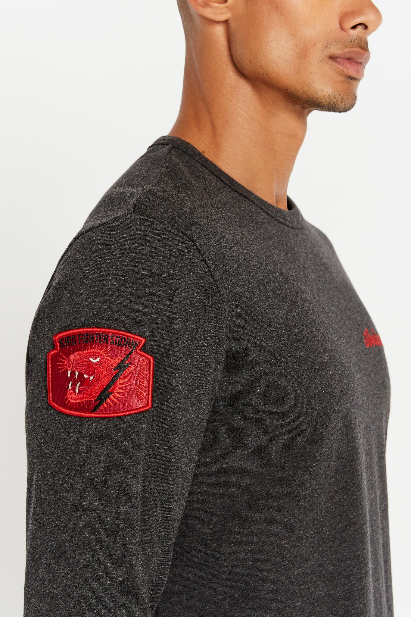 Detailed view of red patch on right sleeve