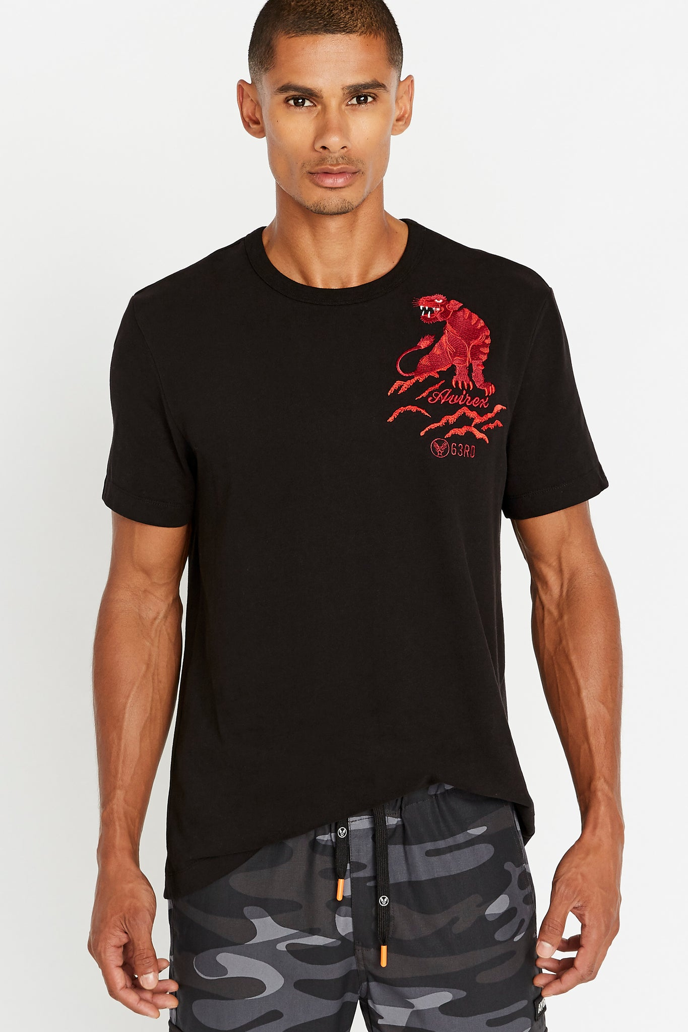 Men wearing a black short sleeve crew neck T-shirt with red panther embroidery on left chest