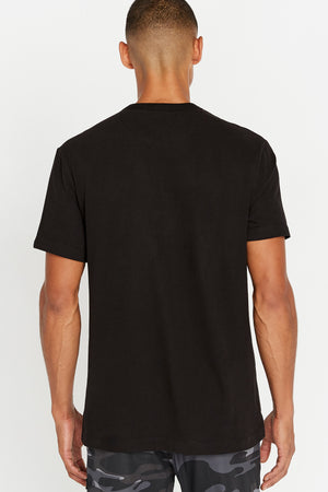 Back view of men wearing a black short sleeve crew neck T-Shirt