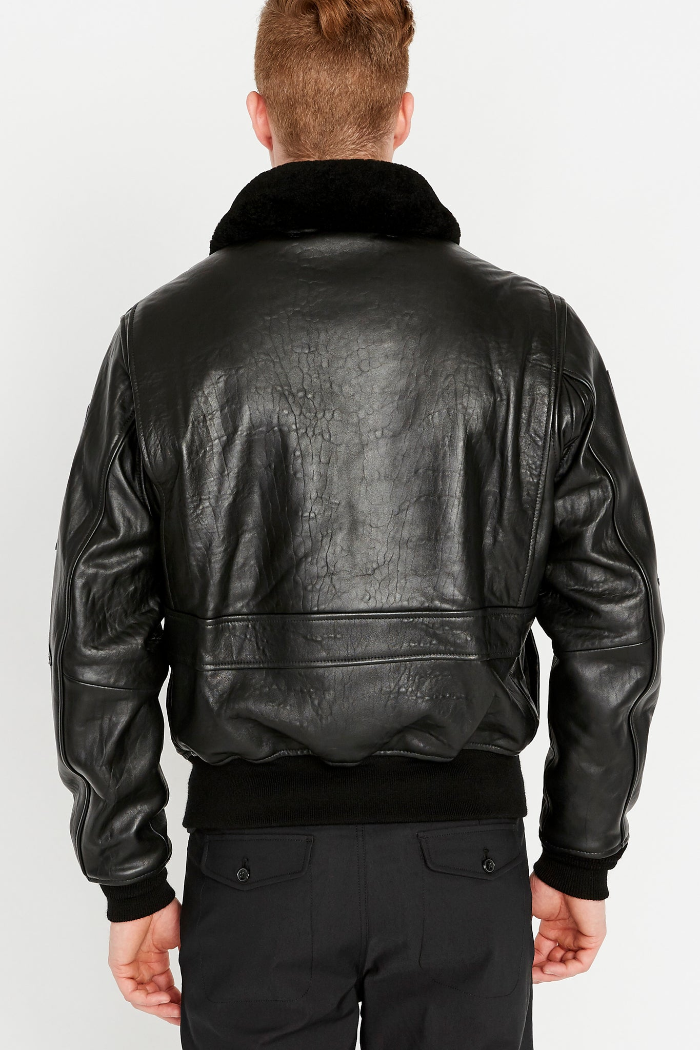 Back view of Men wearing Top Gun G-1 leather jacket with shearling fur lined collar