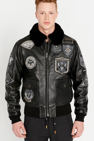 front view of Men wearing fully zipped Top Gun G-1 leather jacket with shearling fur lined collar and blackout Top gun patch design on bodice