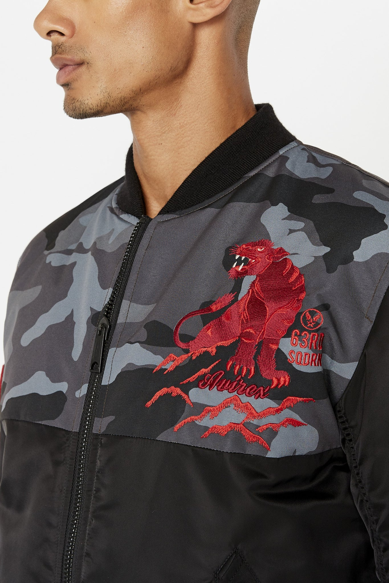 Detailed view of red embroidery panther on the left chest