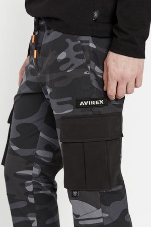 Detailed view of side cargo pockets in solid color with Avirex patch above