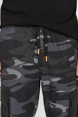 Detailed view of Avirex branded drawcords on camo cargo pants